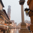 VERONA, ITALY - JANUARY 28, 2013: - Piazza Erbe in rainly dusk and Lamberti tower — Stock Photo #49385423