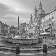 Rome - Piazza Navona in morning and Fountain of Neptune (1574) created by Giacomo della Porta and Santa Agnese in Agone church — Stock Photo #49385495