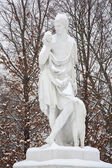 VIENNA, AUSTRIA - JANUARY 15, 2013: Statue of Paris - the son of Priam, king of Troy in gardens of Schonbrunn palace in winter. Statues was generally made between 1773 and 1780. — Stock Photo