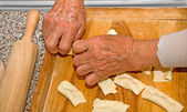 Grandmother hands at baking — Stock Photo