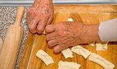 Grandmother hands at baking — Stock Photo