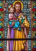 TRNAVA, SLOVAKIA - MARCH 3, 2014: Saint Joseph from windowpane of st. Helen church from 19. cent. — Stock Photo
