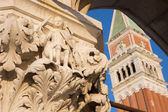 Venice - Detail from capital of Doge palace and bell tower in background — Stok fotoğraf