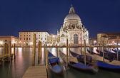 Venice - Santa Maria della Salute church and gondolas in evening dusk — Stock Photo