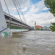 BRATISLAVA - JUNE 5: Danube at high flood by highest measured water and SNP bridge on background on June 5, 2013 in Bratislava, Slovakia. — Stock Photo #49401261