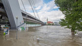 BRATISLAVA - JUNE 5: Danube at high flood by highest measured water and SNP bridge on background on June 5, 2013 in Bratislava, Slovakia. — Stock Photo