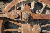 Detail of driving rod mechanism on old steam locomotive in rust — Stock Photo