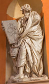 BOLOGNA, ITALY - MARCH 15, 2014: Baroque statue of Saint Luke the Evangelist from west portal of church Chiesa della Madonna di San Luca. — Stock Photo
