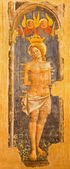 BOLOGNA, ITALY - MARCH 16, 2014: Fresco of st. Sebastian  in church San Giovanni in Monte. — Stockfoto