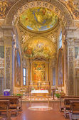 BOLOGNA, ITALY - MARCH 17, 2014: Presbytery and main altar of church San Michele in Bosco with the paint by Frederico Gnudi (1850) and fresco by C. M. Canuti. — Stock Photo