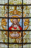 BRUSSELS, BELGIUM - JUNE 15, 2014: The Heart of Jesus in windowpane in church Notre Dame aux Riches Claires by Jan van Keer (1904) — Stock Photo