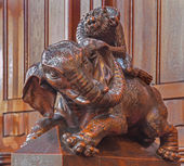 BRATISLAVA, SLOVAKIA - FEBRUARY 11, 2014: Elephant symbolic carved sculpture from bench in presbytery in st. Matins cathedral from years 1863 - 1878 from manufactures of A. Furst a J. Hutterer. — Stock Photo
