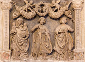 VIENNA, AUSTRIA - FEBRUARY 17, 2014: Stone relief from back side of Church of the Teutonic Order or Deutschordenkirche with the st. John the Baptist, st. Ann and other sanit. — Stock Photo