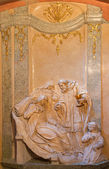 VIENNA, AUSTRIA - FEBRUARY 17, 2014: Relief from side chapel of st. John the Nepomuk in baroque st. Annes church. Scene form life of the saint at Eucharist giving. — Stock Photo
