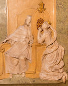 VIENNA, AUSTRIA - FEBRUARY 17, 2014: Relief from side chapel of st. John the Nepomuk in baroque st. Annes church. Scene form life of the saint at convession of thw queen. — Stock Photo