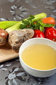 Beef broth with a piece of veal — Stock Photo