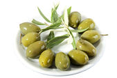 Green olives in brine — Stock Photo