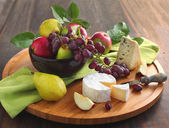 Cheese board with fruits — Stock Photo