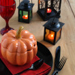 Halloween table setting with candles — Stock Photo #13612525