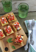 Grill corn polenta with tomato, feta and olive — Stock Photo