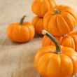 Pumpkins on a wooden table — Stock Photo #14496639