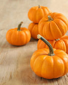 Pumpkins on a wooden table — Stok fotoğraf