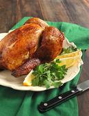 Roast chicken seasoned with herbs and lemon — Stock Photo