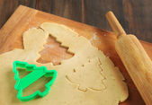 Baking background with dough and cookie cutters — Stock Photo