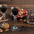Two glasses of Coffee Liqueur, chocolate and nuts — Stock Photo