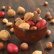 Assorted nuts in a wooden bowl — Stock Photo