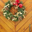 Christmas wreath on a wooden door — Stock Photo