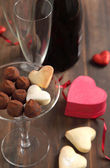 Heart shaped cookies and chocolate truffles — Stock Photo