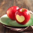 Red apple with a heart shaped cut-out — Stock Photo