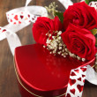 Valentines gift box and bouquet of roses — Stock Photo