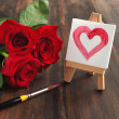 Bouquet of roses and painted heart — Stock Photo