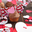 Valentine chocolate cupcake and Valentine card — Stock Photo #18694409