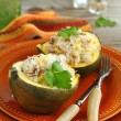 Baked acorn squash with rice and chicken stuffing — Stock Photo