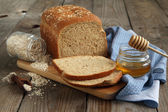 Oatmeal and honey bread — Stock Photo