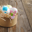 colorful painted easter eggs in brown paper box — Stock Photo