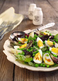 Spring salad with green pea, potato and eggs — Stock Photo