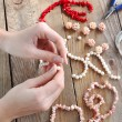 Making a pearl necklace — Stock Photo #24127205