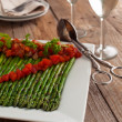 Grilled asparagus, served with a tomato vinaigrette — Stock Photo