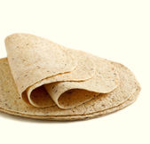Whole wheat tortillas on a white background — Stock Photo