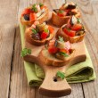 Tomatoes, eggplants and parsley crostini — Stock Photo