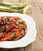 Roasted eggplants with fresh tomatoes and garlic — Stock Photo