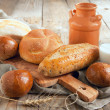 Bakery product assortment with bread loaves and buns — Stock Photo #26314759