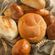 Bakery product assortment with bread loaves and buns — Stock Photo