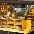 Stockfoto: Assortment of honey and beeswax products. Farmers market.