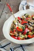 Baked vegetables in baking dish. Vegetarian food. — Stock Photo