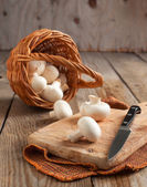 Fresh mushrooms on a wooden chopping board — Stock Photo